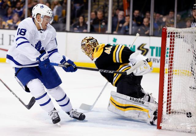 Toronto Maple Leafs' Andreas Johnsson (18), of Sweden, scores on Boston Bruins' Tuukka Rask (40), of Finland, during the first period of Game 5 of an NHL hockey first-round playoff series in Boston, Saturday, April 21, 2018. (AP Photo/Michael Dwyer)