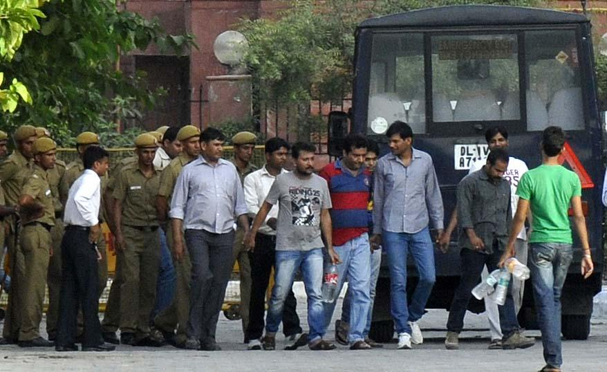 NEW DELHI, INDIA - MAY 21: The Bookies along with the Special Cell Officials leave Saket Court on May 21, 2013 in New Delhi, India. Indian Cricketer S Sreesanth was remanded in further five-day police custody by Metropolitan Magistrate. (Photo by Sonu Mehta/Hindustan Times via Getty Images)