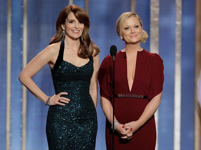 Tina Fey and Amy Poehler host the Golden Globe Awards in 2013Getty Images