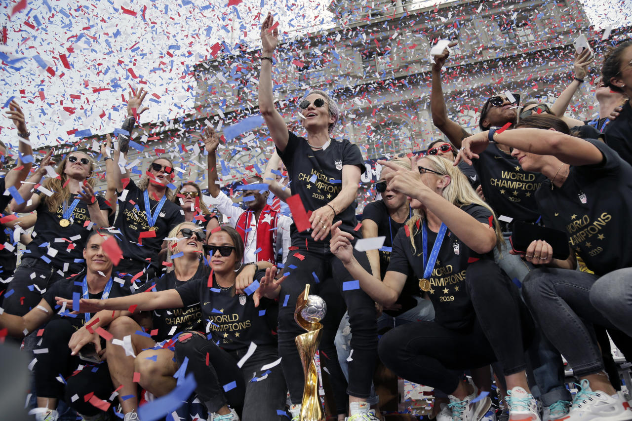 The U.S. women's soccer team celebrates at City Hall after a ticker tape parade, Wednesday, July 10, 2019 in New York. The U.S. national team beat the Netherlands 2-0 to capture a record fourth Women's World Cup title. (AP Photo/Seth Wenig)