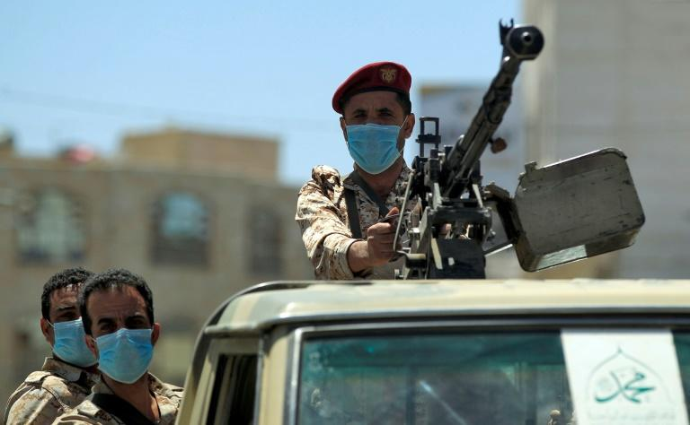 A Yemeni soldier loyal to the Huthi rebels mans a machine gun turret in the back of a pickup truck during a patrol in the capital Sanaa (AFP Photo/MOHAMMED HUWAIS)