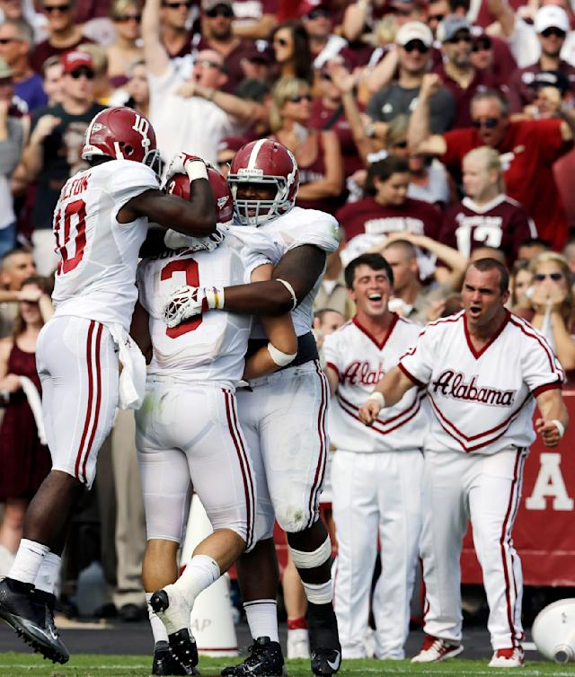 Alabama defensive back Vinnie Sunseri (3) celebrates after returning an interception 73-yards for a touchdown against Texas A&M with teammates John Fulton (10), Jeoffrey Pagan (8) during the third quarter of an NCAA college football game Saturday, Sept. 14, 2013, in College Station, Texas. (AP Photo/David J. Phillip)