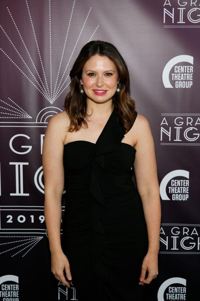 """<p>Best known for her long-time role as Quinn Perkins in Scandal, Katie Lowes stars as 'Rachel' in Inventing Anna, """"a natural born follower"""" whose """"blind worship of Anna almost destroys her job, her credit and her life,"""" according to Netflix.</p><p>The character is thought to be based on Rachel DeLoache Williams, a friend of Anna's who was left paying thousands after a trip with the con woman, and later wrote the book My Friend Anna telling the full story.</p>"""