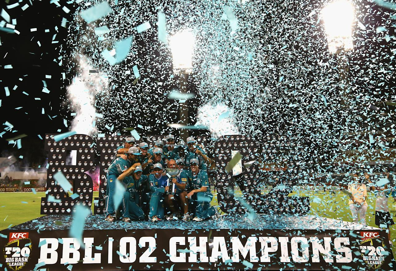 PERTH, AUSTRALIA - JANUARY 19:  The Brisbane Heat celebrate after they defeated the Scorchers in the Big Bash League final match between the Perth Scorchers and the Brisbane Heat at the WACA on January 19, 2013 in Perth, Australia.  (Photo by Robert Cianflone/Getty Images)