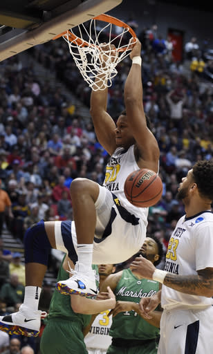 West Virginia forward Sagaba Konate (50) dunks against Marshall during the first half of a second-round NCAA college basketball tournament game Sunday, March 18, 2018, in San Diego. (AP Photo/Denis Poroy)