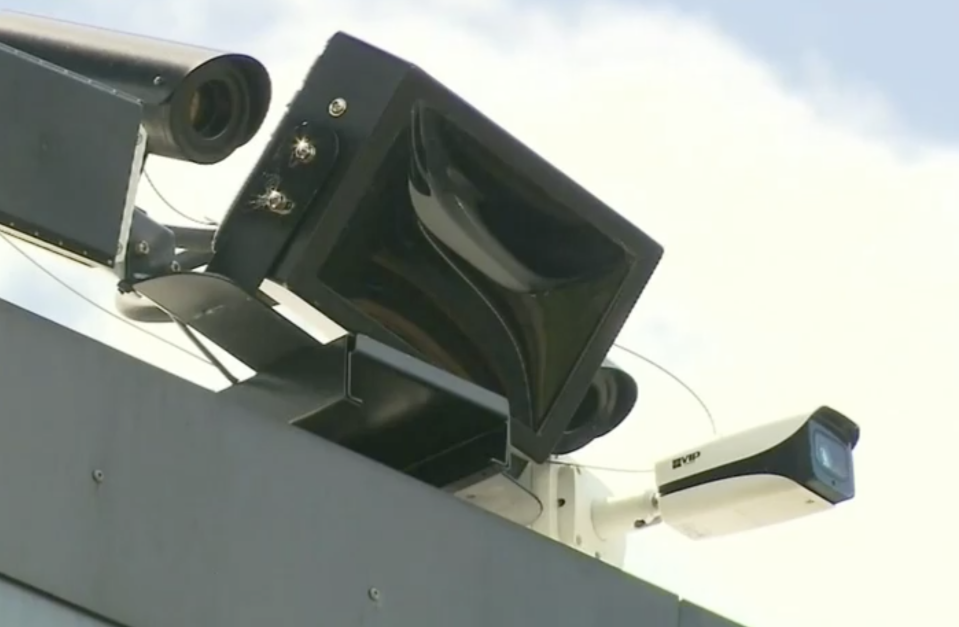 There is debate over whether signs should be installed to warn drivers they are approaching a camera. Source: Nine News