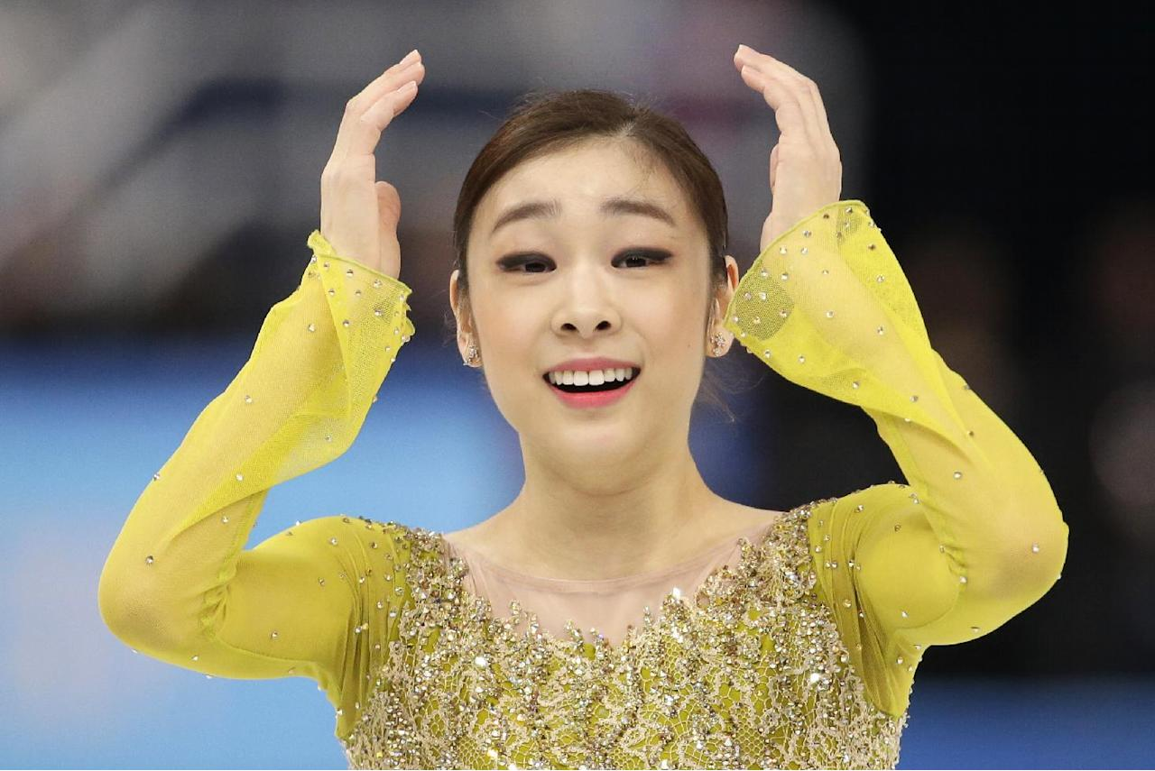 Yuna Kim of South Korea reacts after completing her routine in the women's short program figure skating competition at the Iceberg Skating Palace during the 2014 Winter Olympics, Wednesday, Feb. 19, 2014, in Sochi, Russia. (AP Photo/Bernat Armangue)