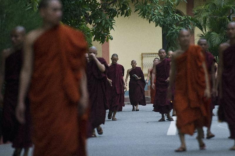 Myanmar Buddhist monks walk through a monastery in Myanmar's second biggest city Mandalay, on August 26, 2015 (AFP Photo/Ye Aung Thu)