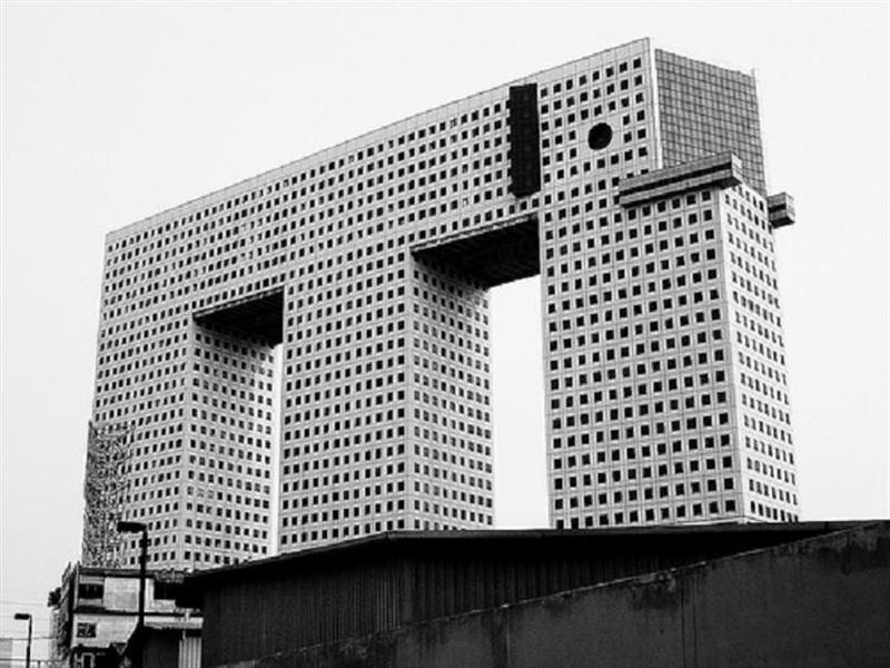 """<b>6. Chang Building (""""The Elephant Tower""""); Bangkok, Thailand</b> It's not that we think the design is that bad and we even like the intended humor. It's the half-hearted execution that turns this potentially fun idea from attraction to eyesore."""
