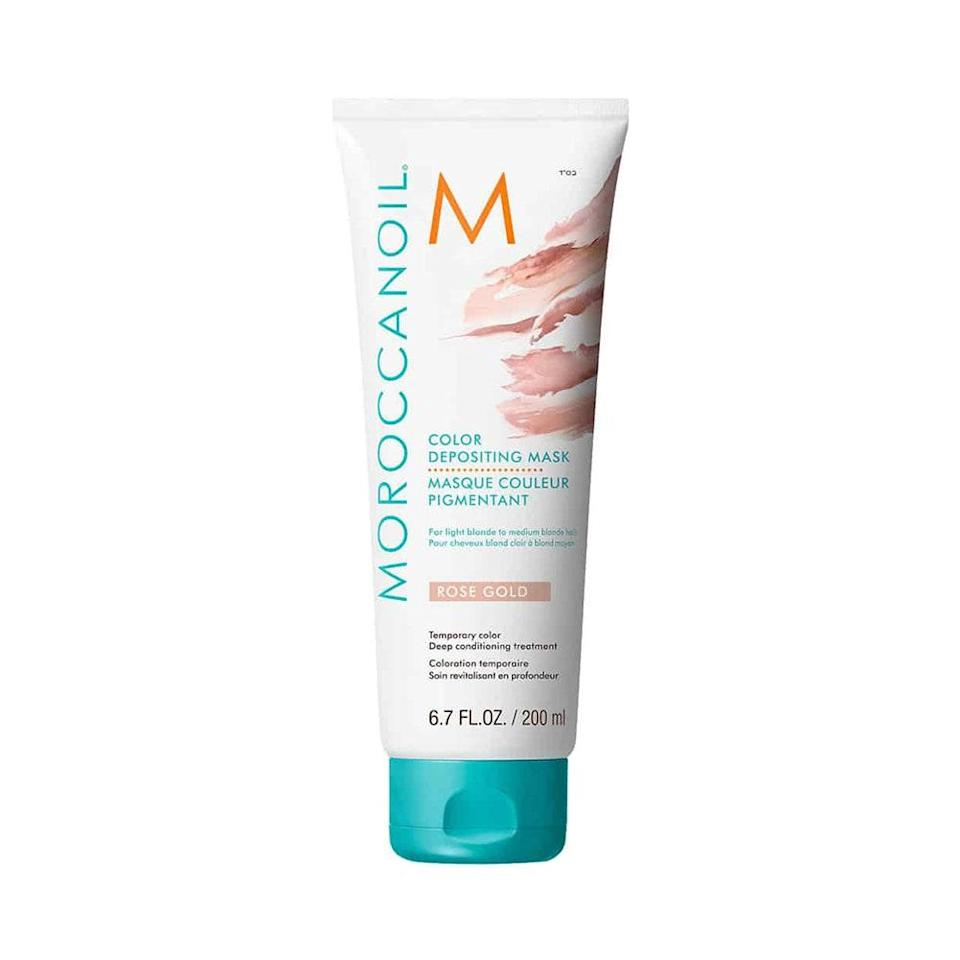 """<p>Moroccanoil Color Depositing Mask ensures your hair stays as healthy and nourished as possible by infusing color (in this case, a lovely rose gold hue) into a <a href=""""https://www.allure.com/gallery/best-hair-masks-for-damaged-hair?mbid=synd_yahoo_rss"""" rel=""""nofollow noopener"""" target=""""_blank"""" data-ylk=""""slk:deep-conditioning mask"""" class=""""link rapid-noclick-resp"""">deep-conditioning mask</a>, which contains argan oil, apricot kernel oil, and amino acids to <a href=""""https://www.allure.com/story/best-shampoos-for-thinning-hair?mbid=synd_yahoo_rss"""" rel=""""nofollow noopener"""" target=""""_blank"""" data-ylk=""""slk:support hair growth"""" class=""""link rapid-noclick-resp"""">support hair growth</a> and strengthening. Apply to clean, towel-dried hair and leave it in for five to seven minutes before rinsing, and say hello to silky, tinted hair. </p> <p>Other pink shades: Hibiscus</p> <p><strong>$28</strong> (<a href=""""amazon.com/Moroccanoil-Color-Depositing-Mask-Rose/dp/B07VKNYXML"""" rel=""""nofollow"""" data-ylk=""""slk:Shop Now"""" class=""""link rapid-noclick-resp"""">Shop Now</a>)</p>"""