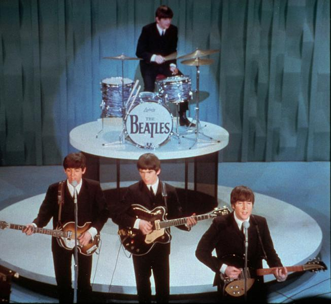 "FILE - The Beatles perform at the ""Ed Sullivan Show,"" in New York in this Feb. 9, 1964 file photo. Universal Music Group can buy the famed British music company EMI, including the hugely lucrative Beatles catalogue, the European Union's competition regulator said Friday Sept 21 2012, but must jettison some of the famed label's other big acts, including Coldplay and Pink Floyd. (AP Photo)"