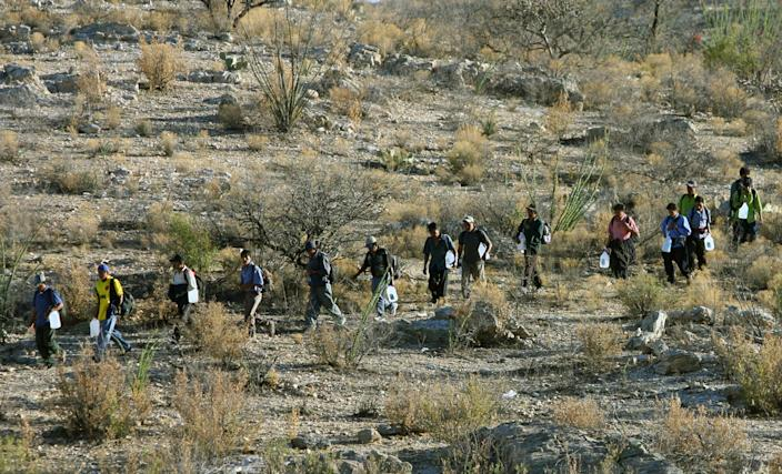 Mexican immigrants walk in line through the Arizona desert near Sasabe, Sonora state, in an attempt to illegally cross the Mexican-US border (AFP Photo/Omar Torres)