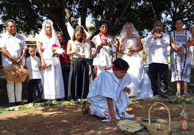 A group of environmental activists hold a traditional ceremony.
