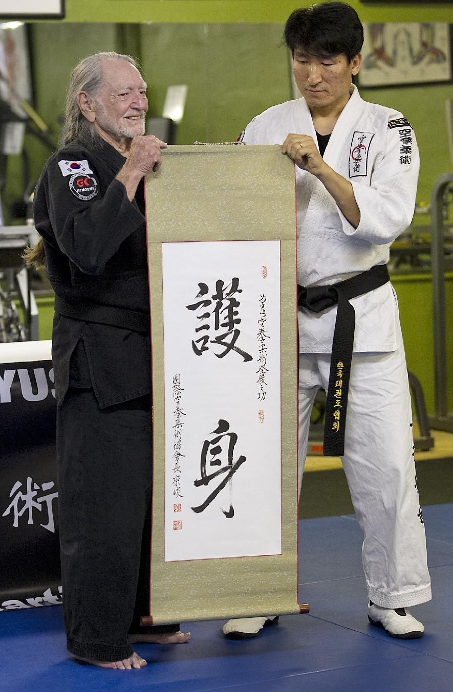 Willie Nelson, the country music icon who turns 81 this week, receives his fifth-degree black belt in the martial art of Gong Kwon Yu Sul on Monday, April 28, 2014, in Austin, Texas. (AP Photo/Austin American-Statesman, Ralph Barrera) AUSTIN CHRONICLE OUT, COMMUNITY IMPACT OUT, INTERNET AND TV MUST CREDIT PHOTOGRAPHER AND STATESMAN.COM, MAGS OUT