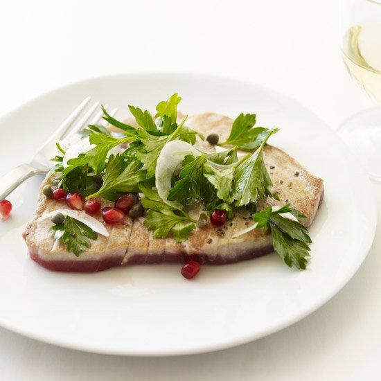 """<p>Lightly seared tuna steaks pair well with a light salad of parsley, pomegranate seeds and fennel.</p><p><a href=""""https://www.foodandwine.com/recipes/tuna-scallopine-with-parsley-and-pomegranate-seeds"""">GO TO RECIPE</a></p>"""