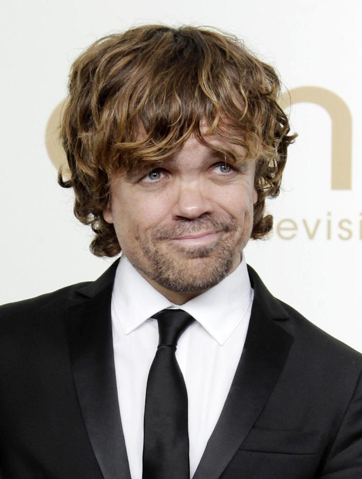 """FILE - In this Sept. 18, 2011 file photo, Peter Dinklage from the HBO series """"Game of Thrones"""" poses backstage at the 63rd Primetime Emmy Awards in Los Angeles. Dinklage won the Emmy for best supporting actor in a drama series for his role as Tyrion Lannister. Dinklage, 43, who has been a vegetarian since he was 16, is the national spokesman for Farm Sanctuary's annual Walk for Farm Animals. He has filmed a YouTube video and will spend his off season promoting the group's campaign to change the way society views and treats farm animals. (AP Photo/Jae Hong, file)"""