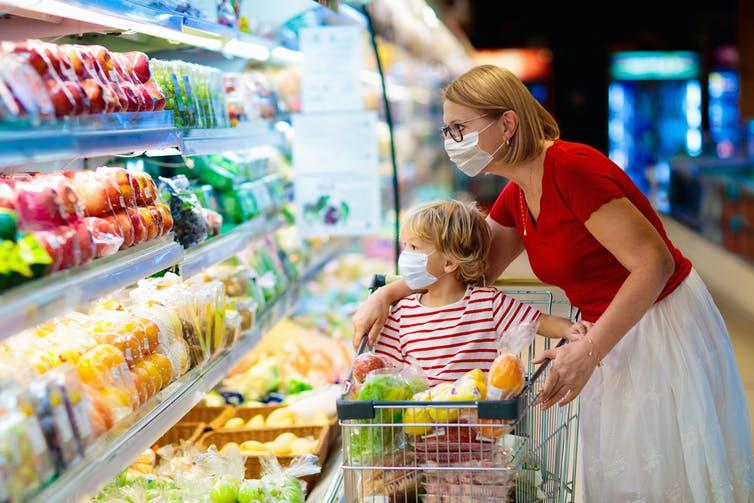 Woman and child in supermarket with trolley