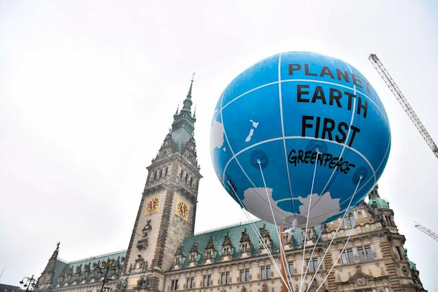 <p>A balloon is lifted in front of the Hamburg city hall (Rathaus) during a demonstration called by several NGOs ahead of the G20 summit in Hamburg on July 2, 2017. (John MacDougall/AFP/Getty Images) </p>