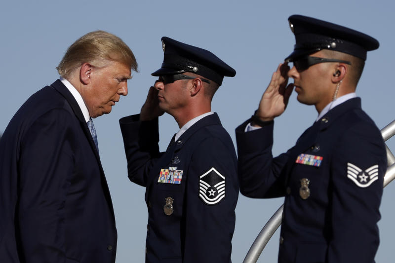 President Donald Trump boards Air Force One at Marine Corps Air Station Miramar, Wednesday, Sept. 18, 2019, in San Diego, Calif. (AP Photo/Evan Vucci)