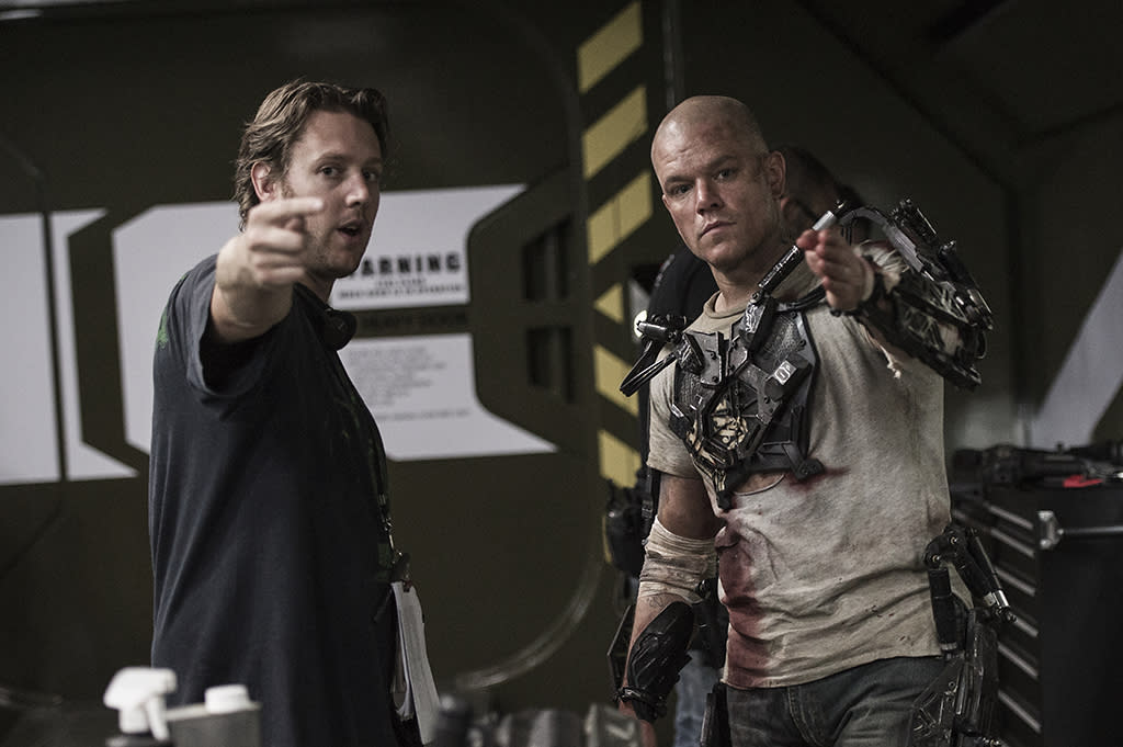 Director Neill Blomkamp (left) and Matt Damon on the set of TriStar Pictures' ELYSIUM.