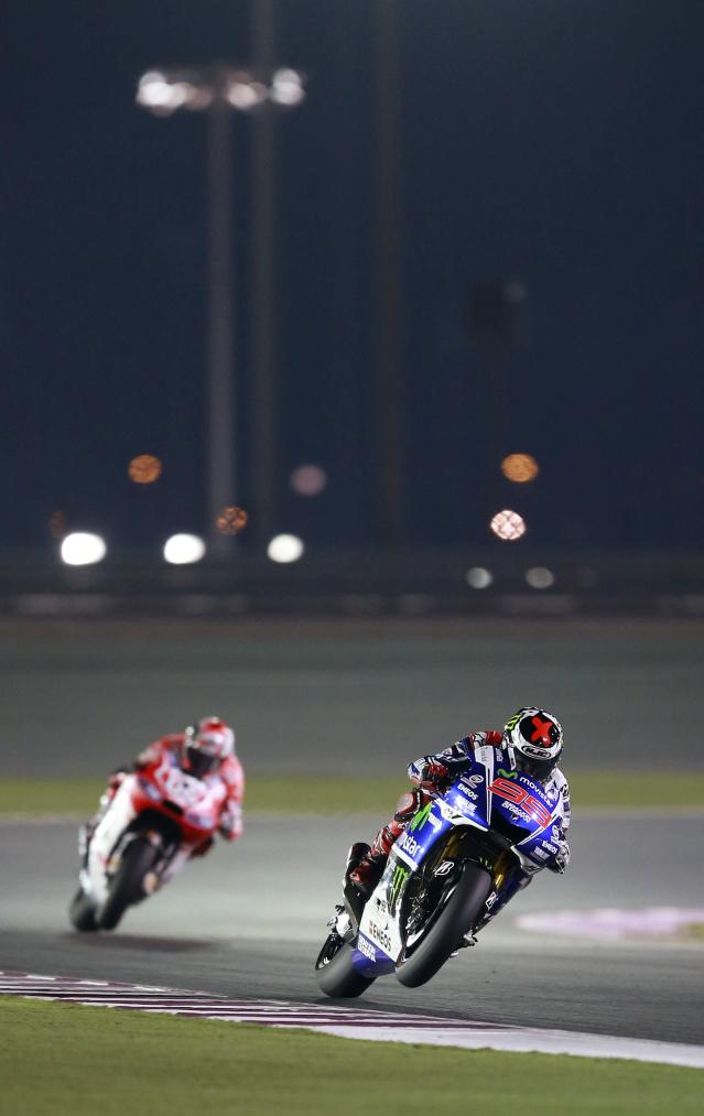 Yamaha MotoGP rider Jorge Lorenzo (R) of Spain races during a free practice session at the MotoGP World Championship at the Losail International circuit in Doha March 22, 2014. REUTERS/Mohammed Dabbous (QATAR - Tags: SPORT MOTORSPORT)