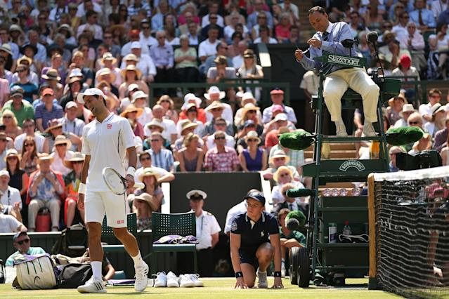 LONDON, ENGLAND - JULY 07: Novak Djokovic of Serbia reacts after speaking with Chair Umpire Mohamed Lahyani during the Gentlemen's Singles Final match against Andy Murray of Great Britain on day thirteen of the Wimbledon Lawn Tennis Championships at the All England Lawn Tennis and Croquet Club on July 7, 2013 in London, England. (Photo by Clive Brunskill/Getty Images)