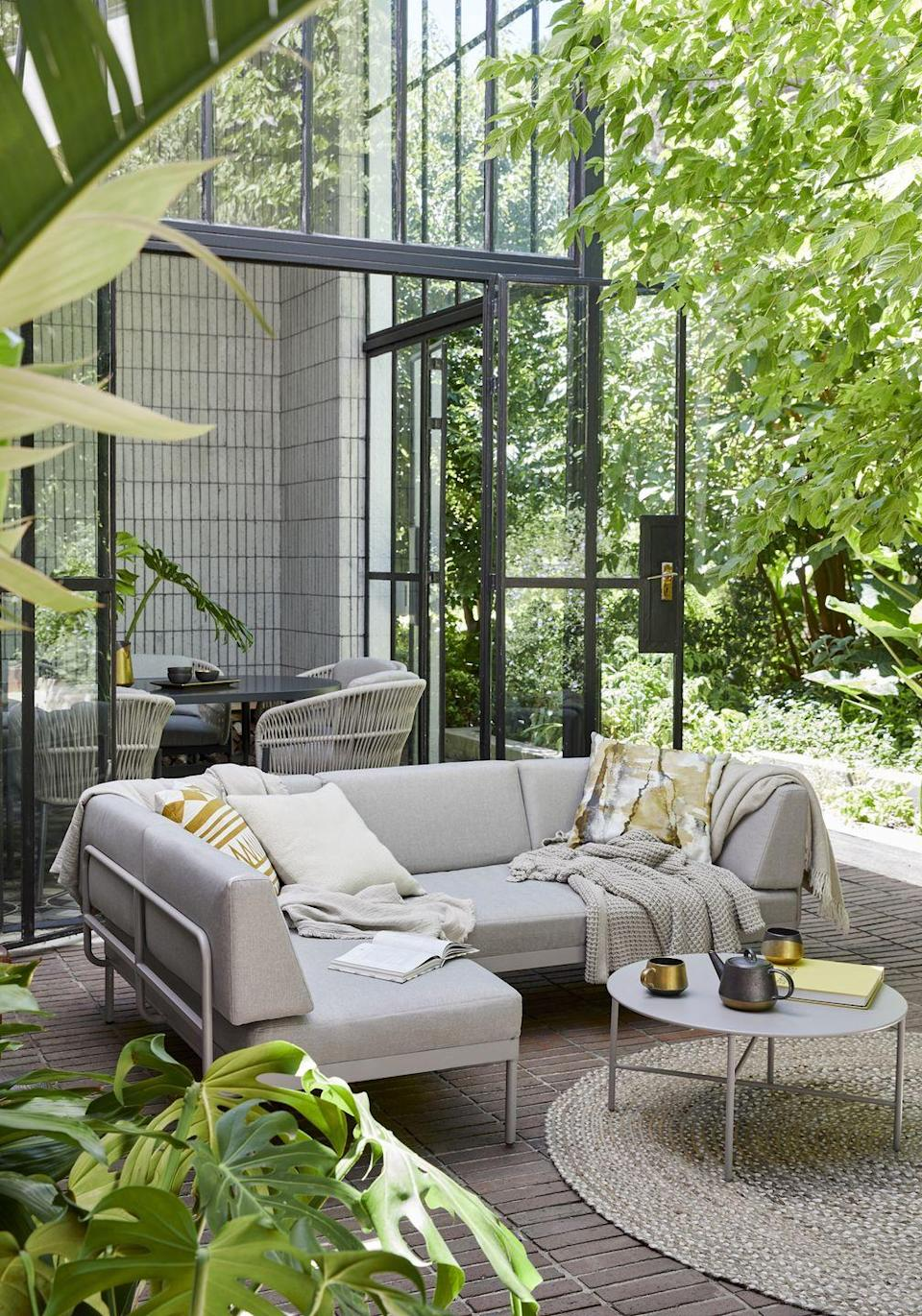 """<p>Spruce up your outdoor space with a cosy <a href=""""https://www.housebeautiful.com/uk/garden/g32443194/best-garden-sofa/"""" rel=""""nofollow noopener"""" target=""""_blank"""" data-ylk=""""slk:corner sofa"""" class=""""link rapid-noclick-resp"""">corner sofa</a>. Complete the look with a selection of outdoor cushions and a string of glistening festoon lights. </p><p><a class=""""link rapid-noclick-resp"""" href=""""https://go.redirectingat.com?id=127X1599956&url=https%3A%2F%2Fwww.johnlewis.com%2Fbrowse%2Ffurniture-lights%2Fgarden%2Fgarden-furniture-sets%2Fgarden-sofa-sets%2F_%2FN-5unsZ1yzi23x&sref=https%3A%2F%2Fwww.redonline.co.uk%2Finteriors%2Fhomeware%2Fg36003381%2Fjohn-lewis-garden-collection-spring-summer%2F"""" rel=""""nofollow noopener"""" target=""""_blank"""" data-ylk=""""slk:SHOP NOW"""">SHOP NOW</a></p>"""