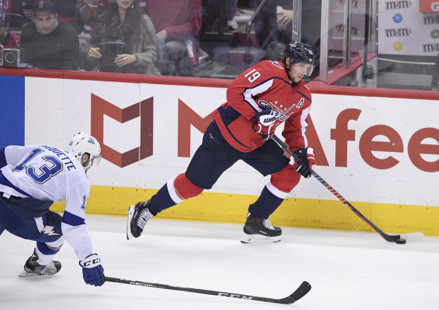 Washington Capitals center Nicklas Backstrom (19), of Sweden, skates with the puck past Tampa Bay Lightning center Cedric Paquette (13) during the second period of Game 4 of the NHL hockey Eastern Conference finals Thursday, May 17, 2018, in Washington. (AP Photo/Nick Wass)