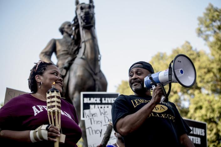 Tami Sawyer and Rev. Earle Fisher of Take 'Em Down 901 at a rally at the Nathan Bedford Forrest statue on August 12, 2017. (Photo: Andrea Morales)