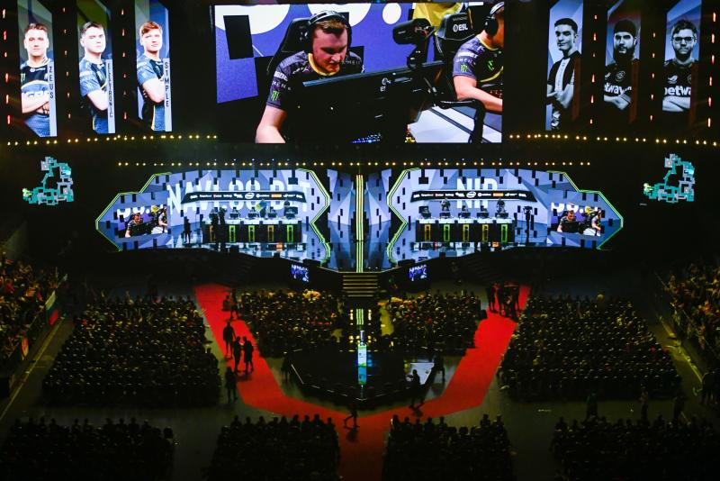 Members of the teams 'NAVI.GG.BET' and 'Ninjas in pyjamas' compete during the ESL ONE Counter-Strike video game tournament at the Lanxess Arena in Cologne, western Germany, on July 5, 2019. (Photo by INA FASSBENDER / AFP) (Photo credit should read INA FASSBENDER/AFP/Getty Images)