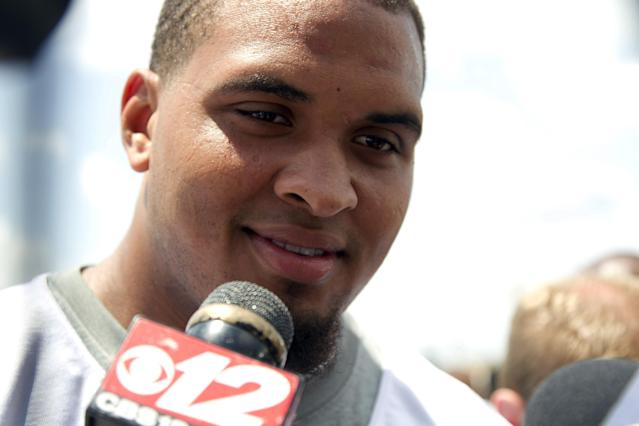 Miami Dolphins' Mike Pouncey talks to the media after an organized team activity Tuesday, May 27, 2014, in Davie, Fla. Pouncey claims to have no regrets about last season's incidents in a bullying scandal in which an NFL-sanctioned investigator identified him and two teammates as principals involved. ( AP Photo/J Pat Carter)