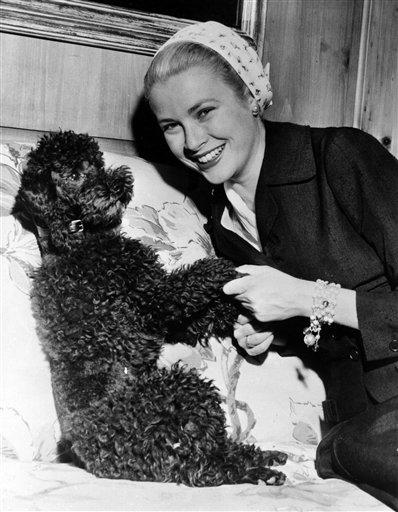"""Grace Kelly with her pet poodle """"Oliver"""" upon her return home from France, May 1955, at her home in Philadelphia, PA., USA. (AP Photo/Str)"""