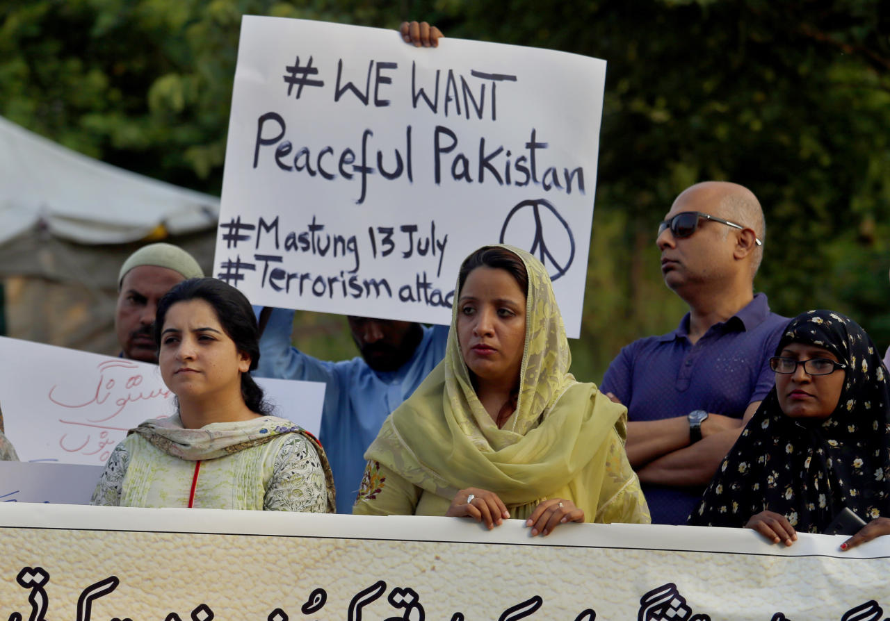 Members of a civil society hold a demonstration to condemn Friday's deadliest suicide bombing, in Islamabad, Pakistan, Saturday, July 14, 2018. Disgraced former Prime Minister Nawaz Sharif was in custody on Saturday, a day after the deadliest attacks in Pakistan's troubled election campaign killed more than 130 people, including a candidate. (AP Photo/Anjum Naveed)