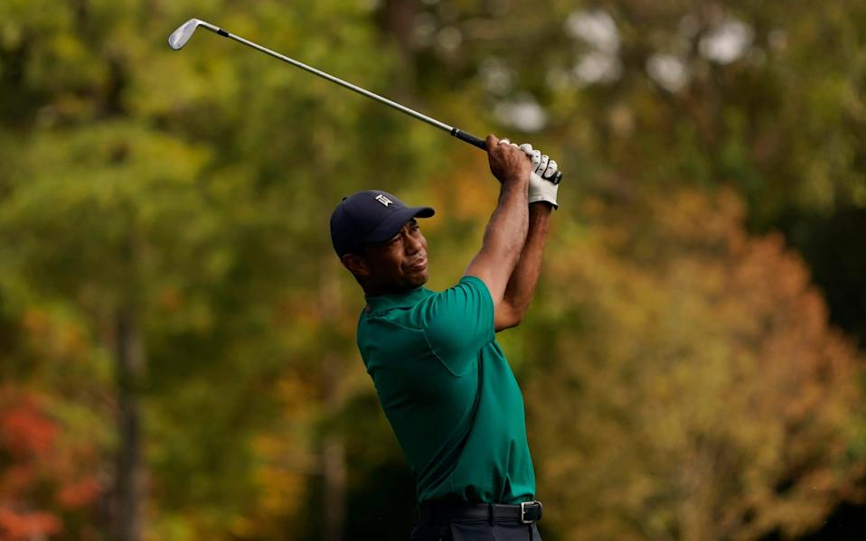 Tiger Woods watches his tee shot on the 12th hole during a practice round for the Masters golf tournament Monday, Nov. 9, 2020, in Augusta, Ga - AP