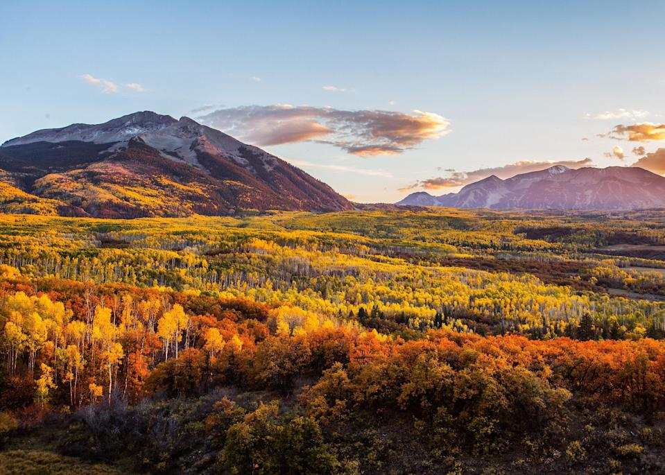 """<p>Aspen may seem like a bit of an obvious choice—hello, mountains famously full of yellow leaves—but obvious isn't always a bad thing. Plus, some of the city's hotels are offering up some season-specific perks that make this fall a freshly great time to visit. </p> <p><a href=""""https://www.cntraveler.com/hotels/united-states/aspen/hotel-jerome--aspen?mbid=synd_yahoo_rss"""" rel=""""nofollow noopener"""" target=""""_blank"""" data-ylk=""""slk:Hotel Jerome"""" class=""""link rapid-noclick-resp"""">Hotel Jerome</a> can arrange outdoor adventures like fly fishing in the Roaring Fork River or paragliding over Aspen Mountain, and is also offering a special """"<a href=""""https://aubergeresorts.com/hoteljerome/experiences/hike-colorados-most-iconic-peaks"""" rel=""""nofollow noopener"""" target=""""_blank"""" data-ylk=""""slk:Tour de 14ers"""" class=""""link rapid-noclick-resp"""">Tour de 14ers</a>"""" package, which is catered to those hoping to conquer one of Aspen's mountains that reaches over 14,000 feet. You can choose between a three- and six-day program, both of which include boot camp training and guided hiking tours of the infamous peaks. True to our current climate, W Aspen & Sky Residences is offering a """"<a href=""""https://fave.co/33SPqlk"""" rel=""""nofollow noopener"""" target=""""_blank"""" data-ylk=""""slk:Work, Play & Stay"""" class=""""link rapid-noclick-resp"""">Work, Play & Stay</a>"""" package which upgrades any booking to include a bevy of work-from-home amenities, including an adjustable laptop desk, bluetooth keyboard, and cocktails delivered to your room promptly at 5 p.m. to help you transition from work to relaxation, all for a flat rate of $650.</p> <p>For some of the best foliage views, stop by the Maroon Bells. Located about ten miles west of Aspen, the pair of mountains are some of the most photographed in the entire state. In fact, professional photographers are known to flock to the shores of Maroon Lake well before sunrise to nab that perfect fall shot. <em>—Caitlin Morton</em></p>"""