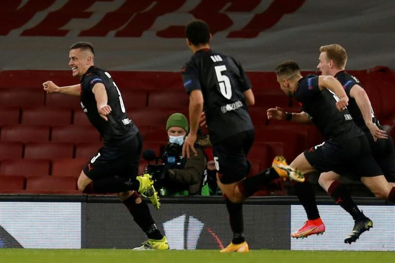 Slavia Prague celebrate their late equaliser against Arsenal in the Europa League quarter-final at the Emirates