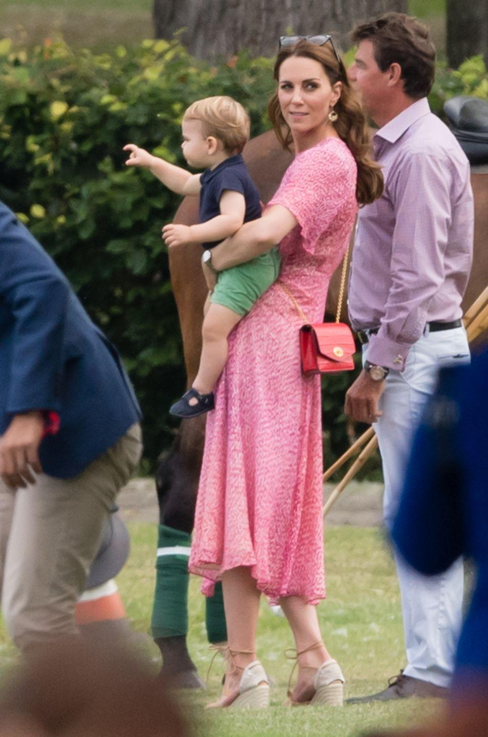 <p>Kate Middleton brought the kids to watch Prince William play in a polo match for charity—and spent quite a bit of time chasing around Prince Louis.</p>