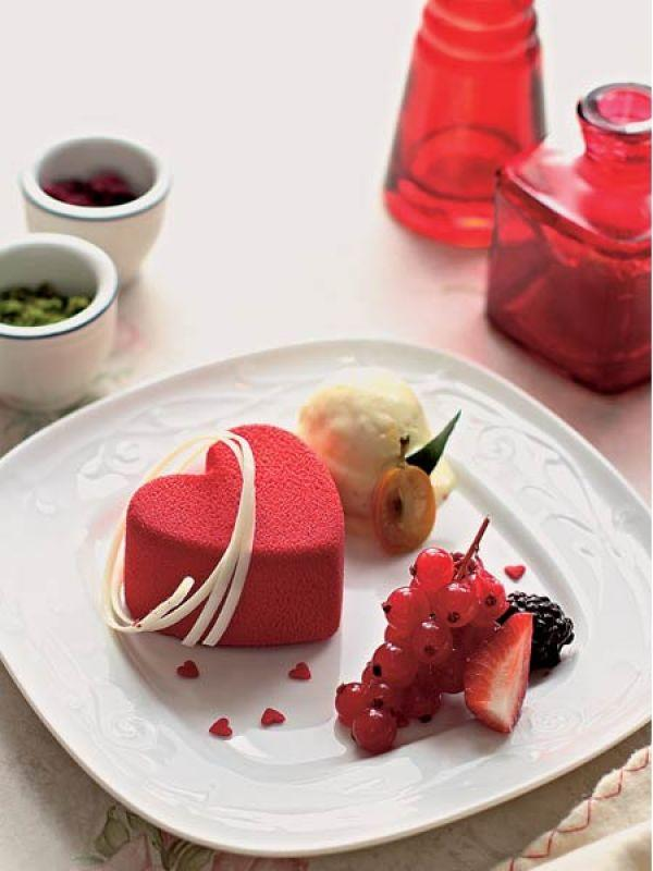 <p>STRAWBERRY MASCARPONE PARFAIT<br /><strong>Ingredients:<br /></strong>For italian meringue: 60 gm egg whites, 180 gm sugar, 75 ml water<br />For the parfait: 375 ml strawberry purée, 20 gm gelatin (soaked in 3 tbsp warm water), 125 gm mascarpone cheese, 225 gm whipped cream, 225 ml fresh cream, 225 gm Italian meringue<br />  <br /><strong>Method: <br /></strong></p> <ol> <li>To make the meringue, whisk egg whites lightly. Simultaneously, put sugar and water in a pan with a candy thermometer and boil until it reaches 120° C.</li> <li>Pour sugar syrup slowly into the egg whites, whisking continuously at high speed, till meringue has cooled and forms peaks.</li> <li>To make the parfait, gently heat strawberry purée. Remove from heat when warm and stir in the soaked gelatin.</li> <li>Cream mascarpone in a bowl until smooth, and fold in whipped cream and fresh cream. Gently fold in Italian meringue and pour into moulds. Refrigerate to set, and serve chilled with ice cream and assorted berries.</li> </ol> <p><br /><strong>Wine guide:<br /></strong>A sweet Chenin blanc from the Loire, a young ruby port from Cockburns or a sparkling sweet Moscato d'Asti from Italy.</p>