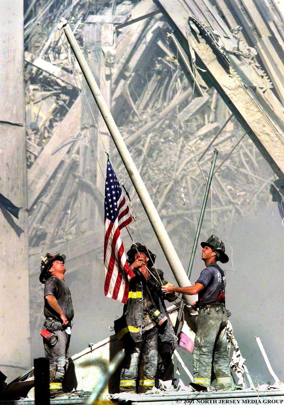 <p>2001. Three firefighters raise the American Flag at Ground Zero in New York City.</p>