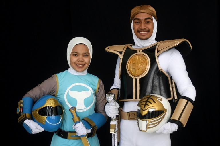 "Muslim cosplay enthusiasts Azlyna Zaina (L) and Raja Mohd Rusydi, dressed as ""Power Rangers "" take part in the ""Hijab Cosplay"" event in Subang Jaya, outside of Kuala Lumpur, on April 29, 2017"