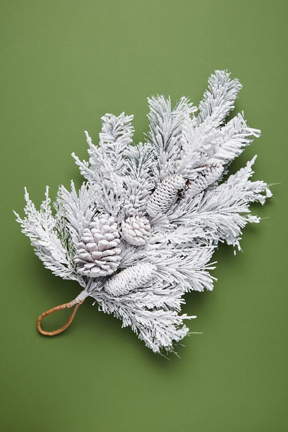"""<p>Bring the wintery feel of the outdoors inside with the <a href=""""https://www.popsugar.com/buy/Flocked-Pinecone-Swag-490506?p_name=Flocked%20Pinecone%20Swag&retailer=anthropologie.com&pid=490506&price=44&evar1=casa%3Aus&evar9=46615300&evar98=https%3A%2F%2Fwww.popsugar.com%2Fhome%2Fphoto-gallery%2F46615300%2Fimage%2F46615376%2FFlocked-Pinecone-Swag&list1=shopping%2Canthropologie%2Choliday%2Cchristmas%2Cchristmas%20decorations%2Choliday%20decor%2Chome%20shopping&prop13=mobile&pdata=1"""" rel=""""nofollow noopener"""" class=""""link rapid-noclick-resp"""" target=""""_blank"""" data-ylk=""""slk:Flocked Pinecone Swag"""">Flocked Pinecone Swag</a> ($44).</p>"""