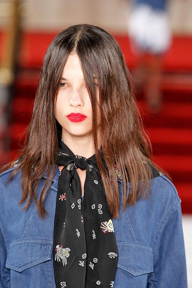 <p>Models wore '90s-style red lipstick by Nars at Creatures of the Wind. (Photo: Getty Images) </p>