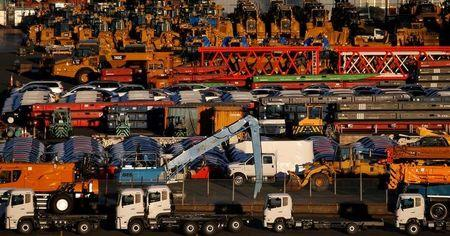 FILE PHOTO: Newly manufactured vehicles await export at port in Yokohama