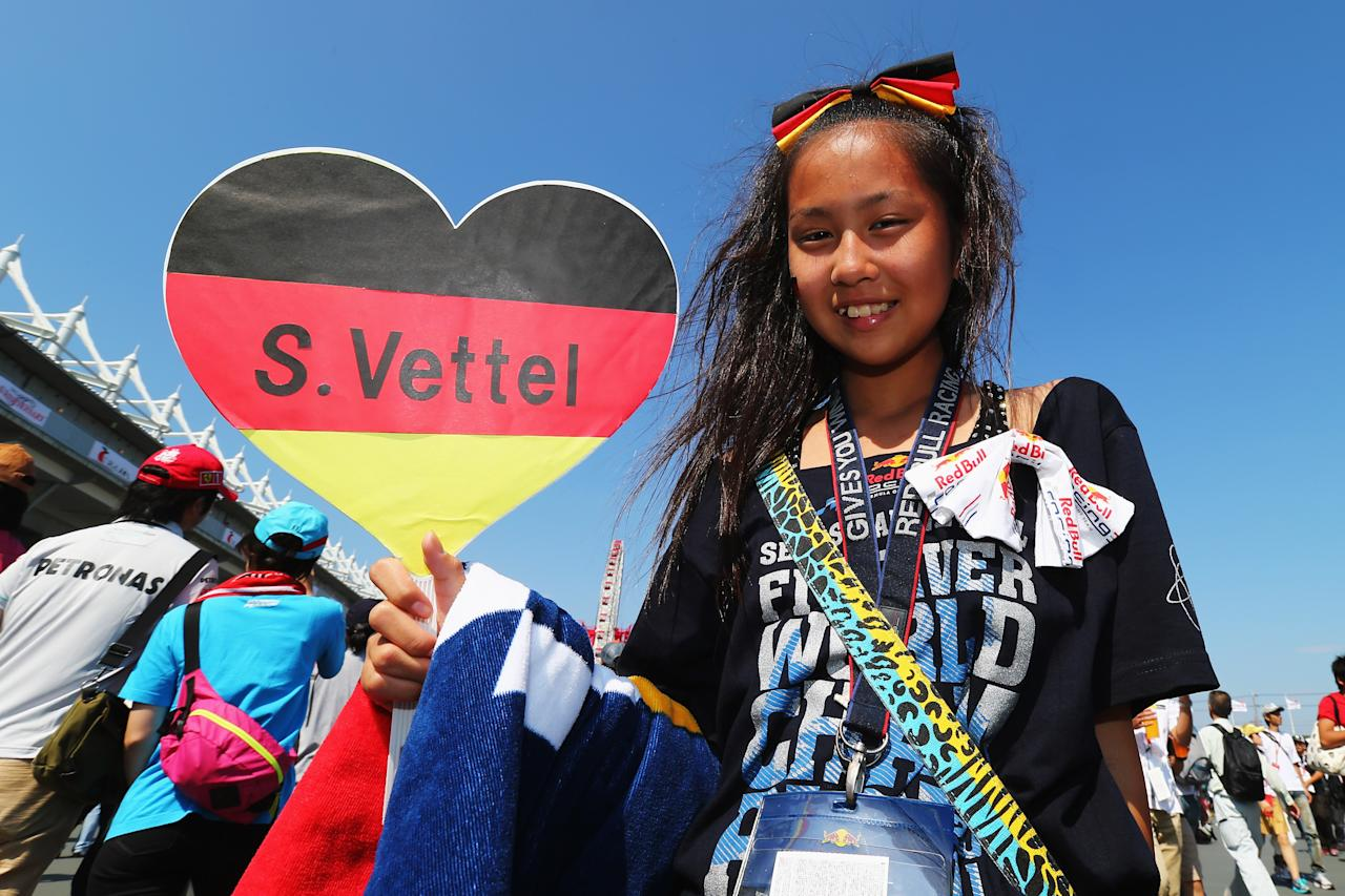 SUZUKA, JAPAN - OCTOBER 07:  Young fan of Sebastian Vettel of Germany and Red Bull Racing attends the Japanese Formula One Grand Prix at the Suzuka Circuit on October 7, 2012 in Suzuka, Japan.  (Photo by Clive Rose/Getty Images)
