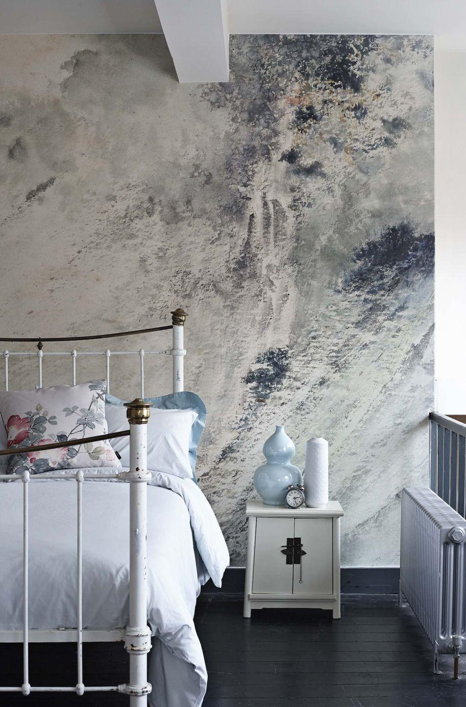 """<p>Paint effects, and particularly concrete effects, are big news at the moment, and this beautiful mural is a case in point. It looks a bit like raw plaster or an abstract painting but it brings grey and navy blue together in a fabulous way and really makes an impression. They are custom printed to your measurements, so there is no wastage.</p><p>Pictured: <a href=""""https://www.surfaceview.co.uk/wallpaper-murals/ash0096"""" rel=""""nofollow noopener"""" target=""""_blank"""" data-ylk=""""slk:Waterfall in a High Mountain Mural by Tao Gu from the Ashmolean Museum Collection. Surface View"""" class=""""link rapid-noclick-resp"""">Waterfall in a High Mountain Mural by Tao Gu from the Ashmolean Museum Collection. Surface View</a></p>"""