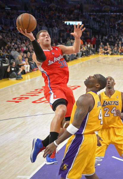 Los Angeles Clippers forward Blake Griffin (32) shoots as Los Angeles Lakers forward Antawn Jamison (4) defends and guard Kobe Bryant (24) watches during the first half of their NBA basketball game, Thursday, Feb. 14, 2013, in Los Angeles. (AP Photo/Mark J. Terrill)