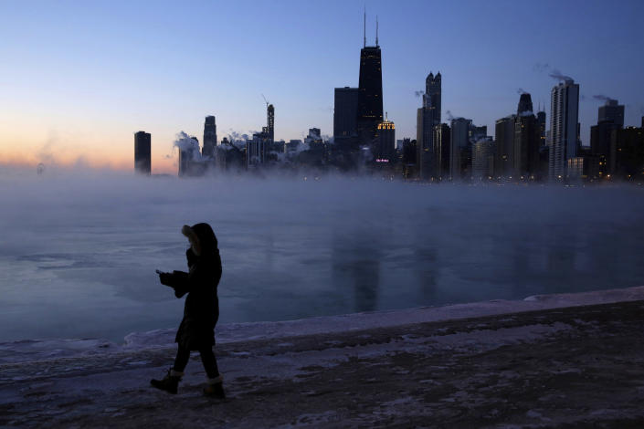 A person walks along the lakeshore on Jan. 30, 2019, in Chicago. A deadly arctic deep freeze enveloped the Midwest with record-breaking temperatures on Wednesday, triggering widespread closures of schools and businesses, and prompting the U.S. Postal Service to take the rare step of suspending mail delivery to a wide swath of the region. (Photo: Kiichiro Sato/AP)