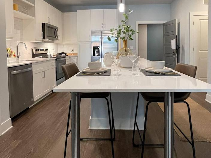Units in the Ellis offer modern kitchens and dining space.