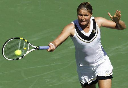Safina of Russia lunges to return a shot against Hantuchova of Slovakia at the Indian Wells WTA tennis tournament in Indian Wells, California