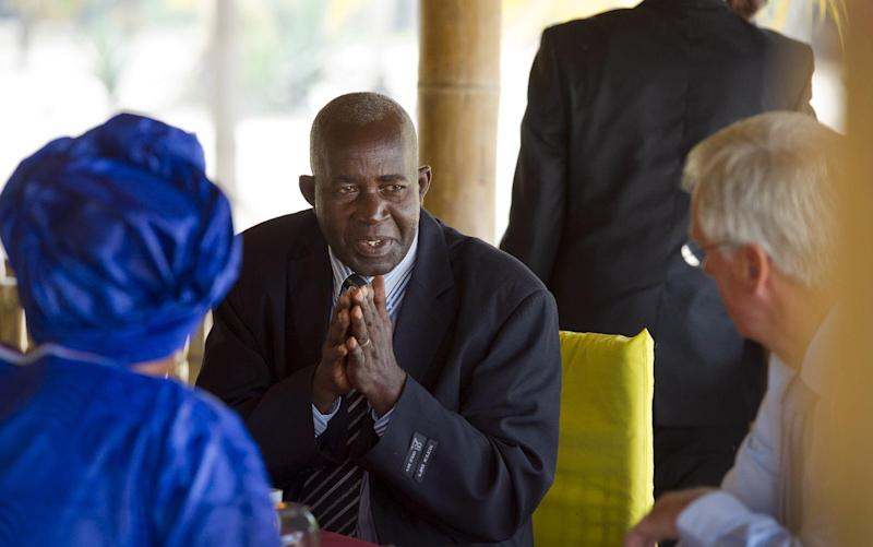 Pierre-Claver Mbonimpa (C) at the Hotel Club du Lac Tanganyika in Bujumbura, Burundi (AFP Photo/Frank van Beek)